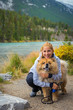 Portrait of the beautiful girl with chow-chow dog